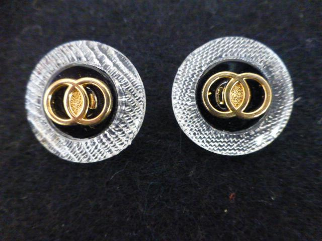 Pair of Black Gold and Clear Rim button