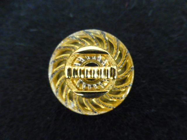 Gold Lucite button